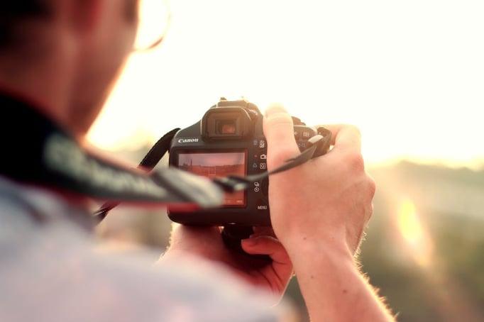 man-camera-taking-photo-photographer.jpg